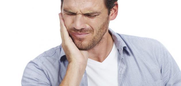 صورة أسباب ألم الفك السفلي والأذن