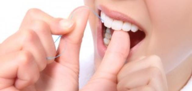 صورة أهمية استخدام خيط الأسنان